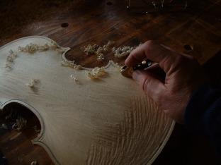 Carving a violin                                       top.